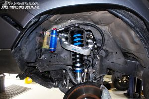 Front left inside guard view of the fitted Superior Front Strut with Coil Spring & Superior Billet Alloy Upper Control Arm