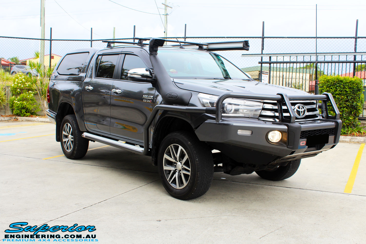 """Left front side view of a Toyota Revo Hilux Dual Cab in Grey after fitment of a Superior Remote Reservoir 3"""" Inch Lift Kit"""