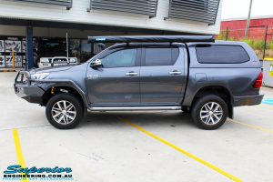 """Left side view of a Toyota Revo Hilux Dual Cab in Grey after fitment of a Superior Remote Reservoir 3"""" Inch Lift Kit"""