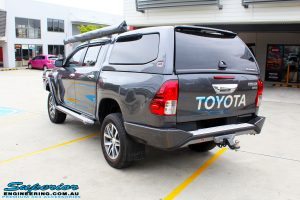 "Rear left view of a Toyota Revo Hilux Dual Cab in Grey after fitment of a Superior Remote Reservoir 3"" Inch Lift Kit"
