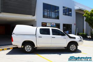 """Right side view of a White Toyota Vigo Hilux Dual Cab before fitment of a 2"""" Inch Lift Kit"""