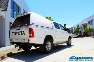"""Rear right view of a White Toyota Vigo Hilux Dual Cab before fitment of a 2"""" Inch Lift Kit"""