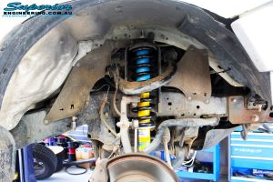 """Right front inside guard view of the fitted Bilstein 2"""" Inch Front Strut + EFS Coil Spring"""