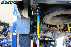 Rear left underbody view of the fitted Bilstein Rear Shocks, EFS Leaf Springs with EFS U-Bolt Kit & Shackles