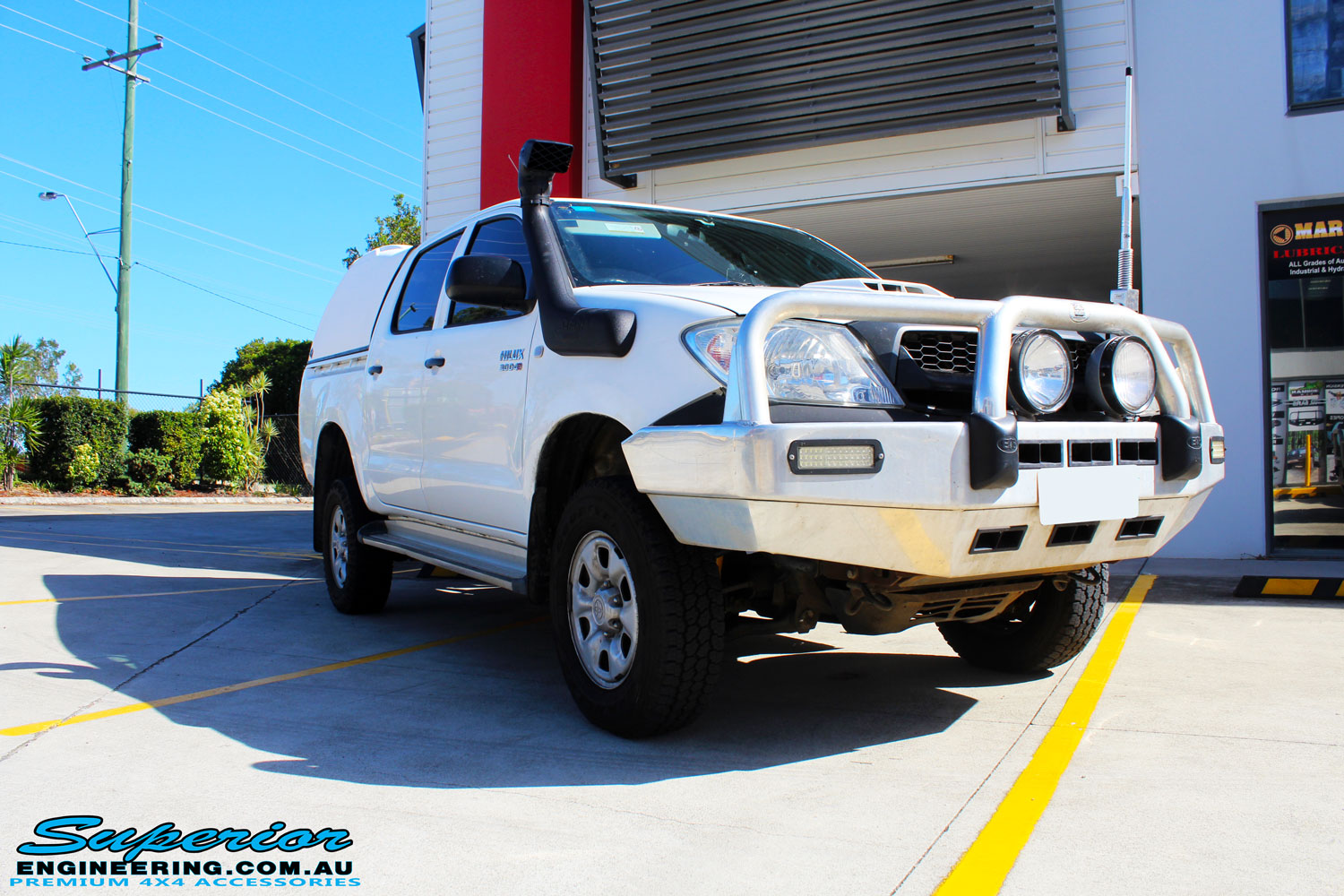 "Right front side view of a White Toyota Vigo Hilux Dual Cab after fitment of a 2"" Inch Lift Kit"