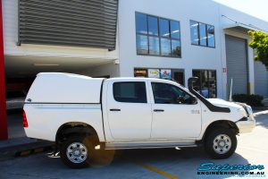 """Right side view of a White Toyota Vigo Hilux Dual Cab after fitment of a 2"""" Inch Lift Kit"""