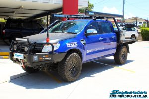"Left front side view of a Ford PX Ranger in Blue before fitment of a Superior 3"" Inch Remote Reservoir Lift Kit with King Springs"