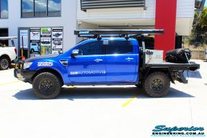 """Left side view of a Ford PX Ranger in Blue before fitment of a Superior 3"""" Inch Remote Reservoir Lift Kit with King Springs"""