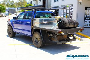 """Left rear right view of a Ford PX Ranger in Blue before fitment of a Superior 3"""" Inch Remote Reservoir Lift Kit with King Springs"""