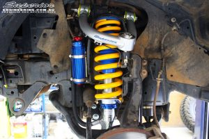 Front left inside guard view of the fitted Remote Reservoir Front Strut + Coil Springs & Superior Upper Control Arms