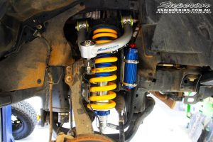 Front right inside guard view of the fitted Remote Reservoir Front Strut + Coil Springs & Superior Upper Control Arms