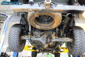Middle rear underbody shot of the fitted Piggy Back Remote Reservoir Shocks, U-Bolt Kit and Rear Leaf Springs