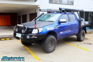 """Left front side view of a Ford PX Ranger in Blue after fitment of a Superior 3"""" Inch Remote Reservoir Lift Kit with King Springs"""
