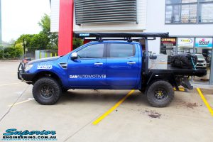 """Left side view of a Ford PX Ranger in Blue after fitment of a Superior 3"""" Inch Remote Reservoir Lift Kit with King Springs"""