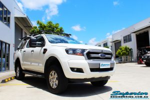 Left front side view of a Ford PXII Ranger in White after fitment of a Tough Dog 40mm Lift Kit