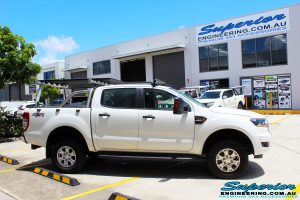 Left side view of a Ford PXII Ranger in White after fitment of a Tough Dog 40mm Lift Kit