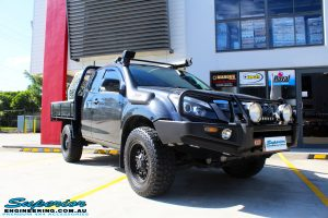 Right front side view of a Black Isuzu D-Max Space Cab being fitted with a Brown Davis Long Range Fuel Tank @ Superior