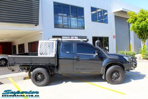 Right side view of a Black Isuzu D-Max Space Cab being fitted with a Brown Davis Long Range Fuel Tank @ Superior