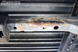 Rear mid under tray shot of a crossmember before being repaired