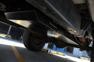 Rear left underbody view of a fitted Brown Davis Long Range Fuel Tank on this D-Max