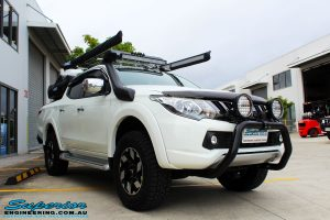 Left front side view of a Mitsubishi MQ Triton Dual Cab after fitment of Superior Nitro Gas Front Struts and Rear Shocks with Front Coil Springs