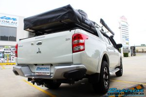 Rear left side view of a Mitsubishi MQ Triton Dual Cab after fitment of Superior Nitro Gas Front Struts and Rear Shocks with Front Coil Springs