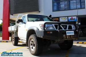 "Right front side view of a White Nissan GU Patrol Ute Wagon before fitment of a Fox 2.0 Performance Series IFP Hybrid Dropped Radius 5"" Lift Kit with Superior Sway Bar Extensions"