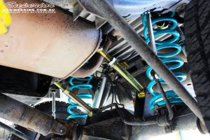 Mid underbody shot looking back on the fitted Superior Rear Upper Control Arms, Coil Springs & Fox 2.0 Performance Series IFP Rear Shocks