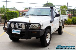 Front right side shot of this Nissan GU Patrol Ute before fitment of a Superior 4-5 Inch Lift Kit with Superior Remote Reservoir Shocks & Superior Hybrid 5 Link Radius Arms