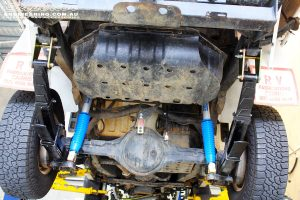 Mid rear underbody shot of the fitted Superior Adjustable Monotube Remote Reservoir Shocks and Dobinson Leaf Springs