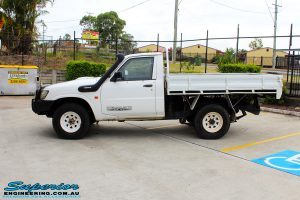 Left side shot of this Nissan GU Patrol Ute before fitment of a Superior 4-5 Inch Lift Kit with Superior Remote Reservoir Shocks & Superior Hybrid 5 Link Radius Arms