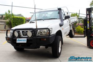 Mid rear shot of this Nissan GU Patrol Ute being flexed before fitment of a Superior 4-5 Inch Lift Kit with Superior Remote Reservoir Shocks & Superior Hybrid 5 Link Radius Arms