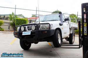 Front left view of this Nissan GU Patrol Ute being flexed from the rear left tyre before fitment of a Superior 4-5 Inch Lift Kit with Superior Remote Reservoir Shocks & Superior Hybrid 5 Link Radius Arms