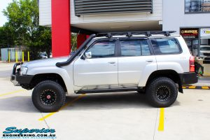 Right side view of a Nissan GU Patrol Wagon in Silver On The Hoist @ Superior Engineering Deception Bay Showroom getting fitted with a Superior Coil Tower Brace Kit