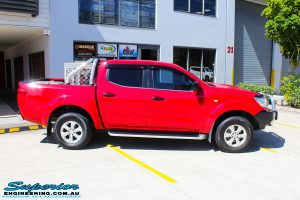 """Right side view of a Nissan NP300 Navara Dual Cab before fitment of a Superior Nitro Gas 2"""" Inch Lift Kit"""