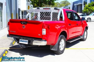 """Rear right view of a Nissan NP300 Navara Dual Cab before fitment of a Superior Nitro Gas 2"""" Inch Lift Kit"""
