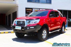 """Right front side view of a Nissan NP300 Navara Dual Cab after fitment of a Superior Nitro Gas 2"""" Inch Lift Kit"""