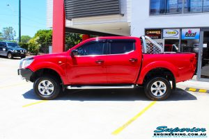 """Right side view of a Nissan NP300 Navara Dual Cab after fitment of a Superior Nitro Gas 2"""" Inch Lift Kit"""