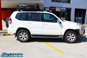 "Right side view of a Toyota 120 Series Prado Wagon before fitment of a 2"" Inch Lift Kit"