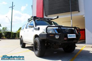 """Right front side view of a Toyota Vigo Hilux Dual Cab in White before fitment of a Superior Remote Reservoir 4"""" Inch Lift Kit with King Springs"""