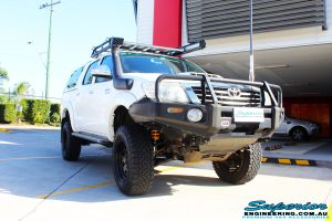 """Right front side view of a Toyota Vigo Hilux Dual Cab in White after fitment of a Superior Remote Reservoir 4"""" Inch Lift Kit with King Springs"""