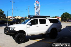 """Right side view of a Toyota Vigo Hilux Dual Cab in White after fitment of a Superior Remote Reservoir 4"""" Inch Lift Kit with King Springs"""