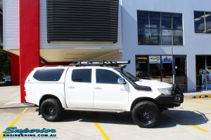 "Right side view of a Toyota Vigo Hilux Dual Cab in White before fitment of a Superior Remote Reservoir 4"" Inch Lift Kit with King Springs"