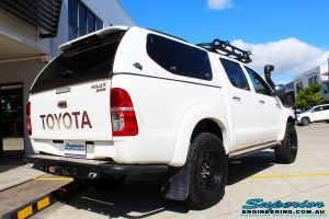"""Rear right view of a Toyota Vigo Hilux Dual Cab in White before fitment of a Superior Remote Reservoir 4"""" Inch Lift Kit with King Springs"""