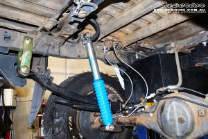 Rear right underbody shot of the fitted Superior Rear Monotube Remote Reservoir Shock with Leaf Spring, U-Bolt and Bush Kit