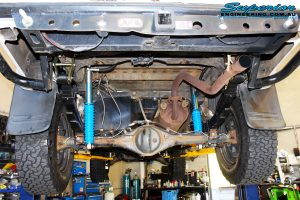 Mid rear underbody shot of the fitted Superior Rear Monotube Remote Reservoir Shocks with Leaf Springs, U-Bolt and Bush Kits