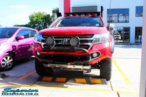 Left right corner view of a Holden RG Colorado Dual Cab in Red after fitment of a Colour Coded Rhino 4x4 Evolution 3D Winch Bar with Warn Winch