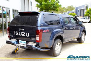 Rear right view of a Isuzu D-Max Dual Cab in Blue ready to be On The Hoist @ Superior being fitted with a Chassis Brace/Repair Plate