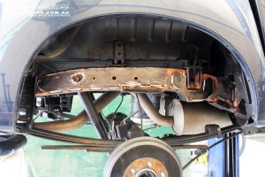 Rear right underbody shot of the Chassis Plate being prepped