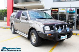"""Right front side view of a Nissan D40 Navara Dual Cab before fitment of a Superior Nitro Gas 2"""" Inch Lift Kit with King Springs & a Safari Snorkel"""